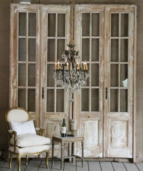 Bi-fold doors in a beautiful seating area vignette... a great way to provide visual interest. #salvage #up-cycle #architectural