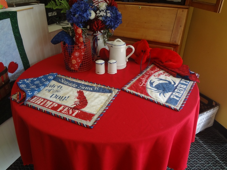Cute summer table with place mats made from seashore fabric.