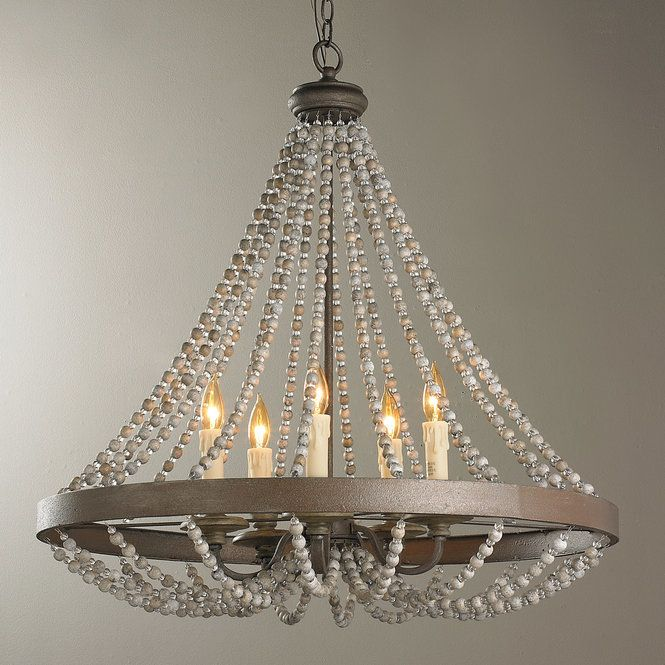 "Alternating clear glass and two-tone (gray and cream) stone beads hang delicately from this 5-light chandelier for a rustic take on a classic design. Metal finish is grayish bronze. Soft white beeswax candle covers. Requires (5) 60 watt candle base bulbs. (30""Hx30""W)Supplied with 10' of chain and 12' of wire."