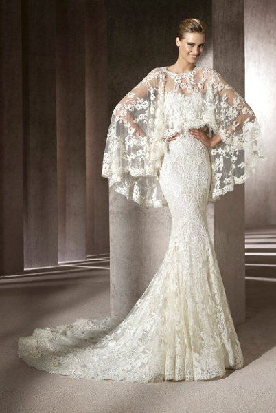 Not vintage, but certainly vintage inspired. Love this Pronovias lace gown by Manuel Mota