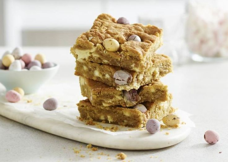 White Chocolate Mini Egg Blondies   Soft, chewy and loaded with chocolate chips and mini eggs, these fudgy blondies are the fairer cousin of the rich, dark brownie, and every bit as delicious! With a lovely crunch from the sugary 'eggshells', they're a perfect treat for Easter.