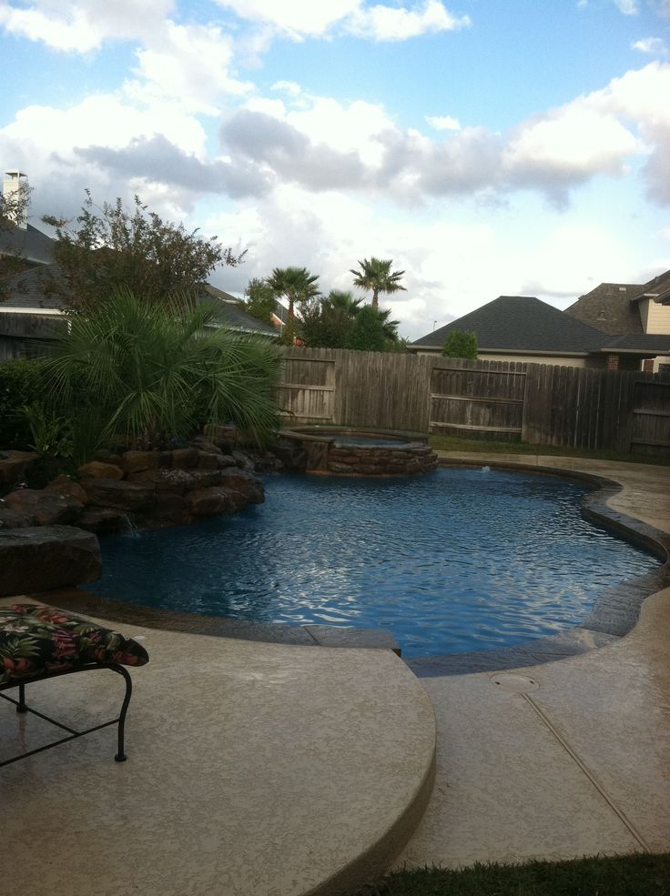 Wet pools inc plaster tahoe blue weeping rock wall for Pool design katy tx