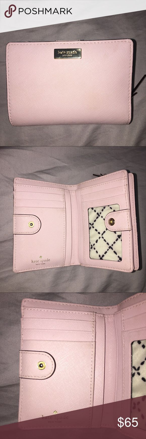 """Kate spade wallet Super cute light pink wallet barely used. Does have a couple of small and very unnoticeable marks and gold hard ware is scratched. Has lots of compartments and ID slot. 5"""" across 3.5"""" top to bottom about 1.5"""" wide kate spade Bags Wallets"""