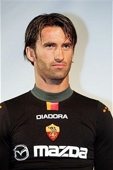A member of the Roma soccer team, Christian Panucci, appears on stage during a party to celebrate the Diadora & A.S. Roma launch of 'Champions League Shirt' at the Guggenheim Museum August 2, 2004 in New York City.