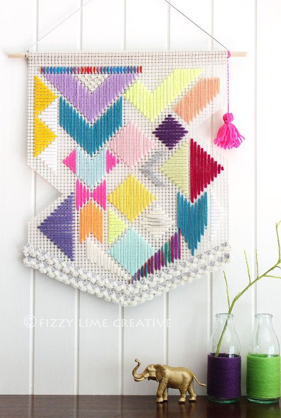 Woven colourful, geometric pattern banner, unique shape with neon pink tassel