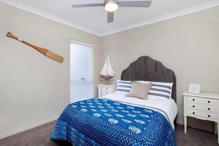 A nautical themed bedroom is perfect for this home next to the water