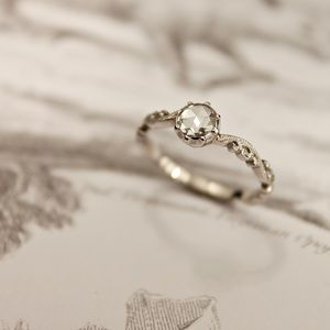 Featuring a stunning Rose-cut white diamond and hand carved band. This ring has been entirely handmade {as opposed to casted} by our experienced mounter here in London. This means that every ring is unique.