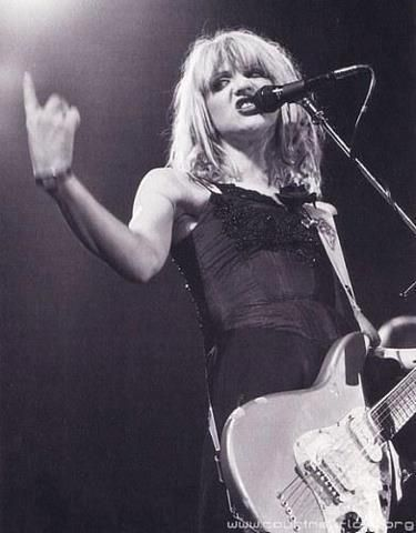 Courtney...She's Brash, She's Wild On Stage...And, Yes, She Can Play That Guitar...