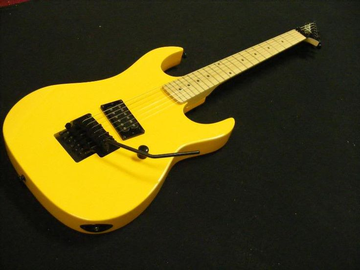 BC Rich Gunslinger Retro -- own this, yes... just one volume control, the ultimate in rock simplicity, natural fingerboard, great neck shape imho.  Be aware that there are Chinese versions (2011 onward) that run around $300 -- no where near the quality of Korean versions which are up around $450.