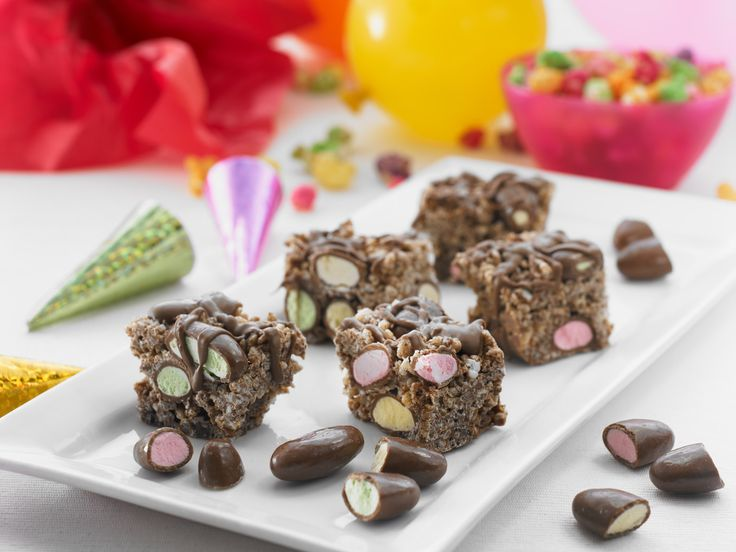 A crunchy chocolate favourite with a colourful twist of CLINKERS lollies.#baking #chocolate To view the #CADBURY product featured in this recipe visit https://www.cadburykitchen.com.au/products/view/bournville-cocoa/