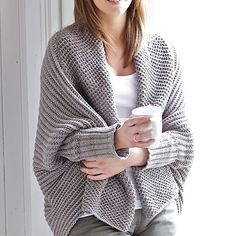 comfy. -- I love that it is not a blanket.... and it isn't a sweater..... hmmmm. I wonder if I have some yarn in my stash to match???? (NOTE: JUST found and added the source!)