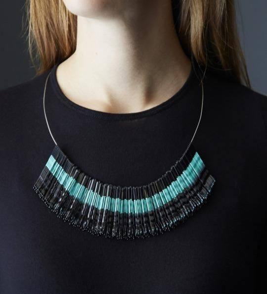 Make your own necklace made outta bobby pins! You can even make a design by painting on it - like a stripe down a stack of these bobby pins.