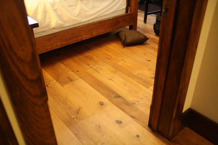 Refinished Bedroom #2, post refinishing, is immediately adjacent to bedroom #1 which was not refinished...previously the colour of the bedframe, visible in this photo, was approximately the same colour/depth of colour as the floor,... the difference between the two rooms (ie vs unrefinished bedroom #1)  is quite apparent,... photo Jan 21,... lighting conditions are identical in both rooms,...
