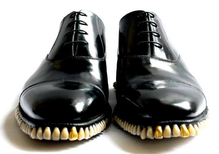 British studio fantich and young have re-interepreted the humble dinner shoe by replacing a regular rubber sole with hundreds of dentures.  the 'apex predator shoe' transforms the elegant savile row oxford shoe, inlaying 1050 fake teeth and accompanies an entire suit made of  human hair and gla