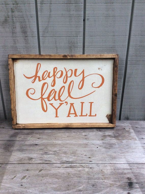 Happy Fall Yall Fall Sign  It is 13 1/2 x 19 1/2 with its frame which is stained a dark walnut  It is white with orange letters  It is hand