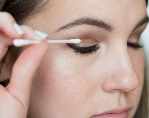 Spin the tip of a cotton swab over a dried mascara mistake to remove the spot without ruining your eyeshadow.