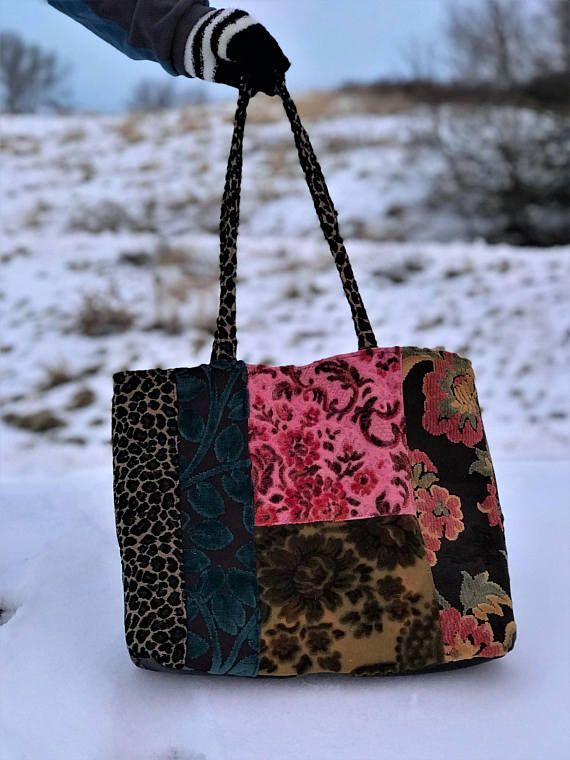 Lush velvet fabrics in cut velvet tote bag, Leopard print handles and accents. Pleather bottom for stability. Inside floral with a magnetic snap closure and a zipper pocket. Contrasting back with a big pocket.
