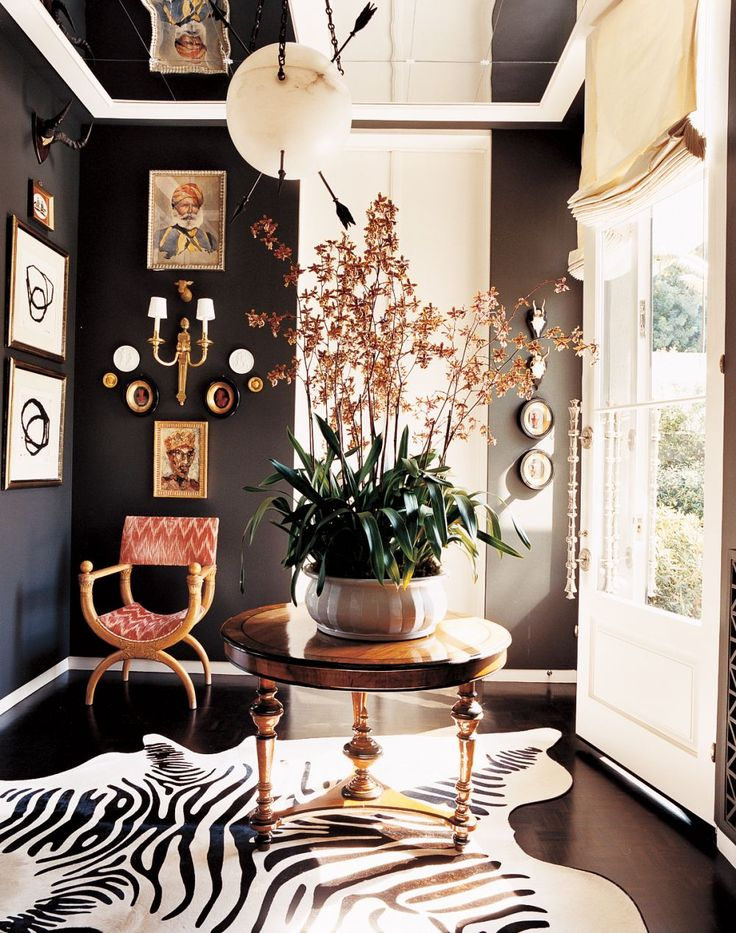 Look At The Orchid On This Foyer Table! The Dark Floor, Dark Walls. Zebra  Cowhide Rug, The Glass Door With That Incredible Handle. The Mirrored  Ceiling!