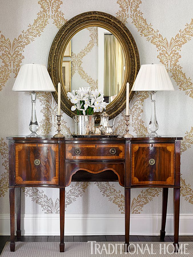 Pretty Sideboard  The custom-colored wallcovering from Designer Classics Wallpaper was inspired by palettes in adjoining rooms. The sideboard, dining table, and mirror are antiques.