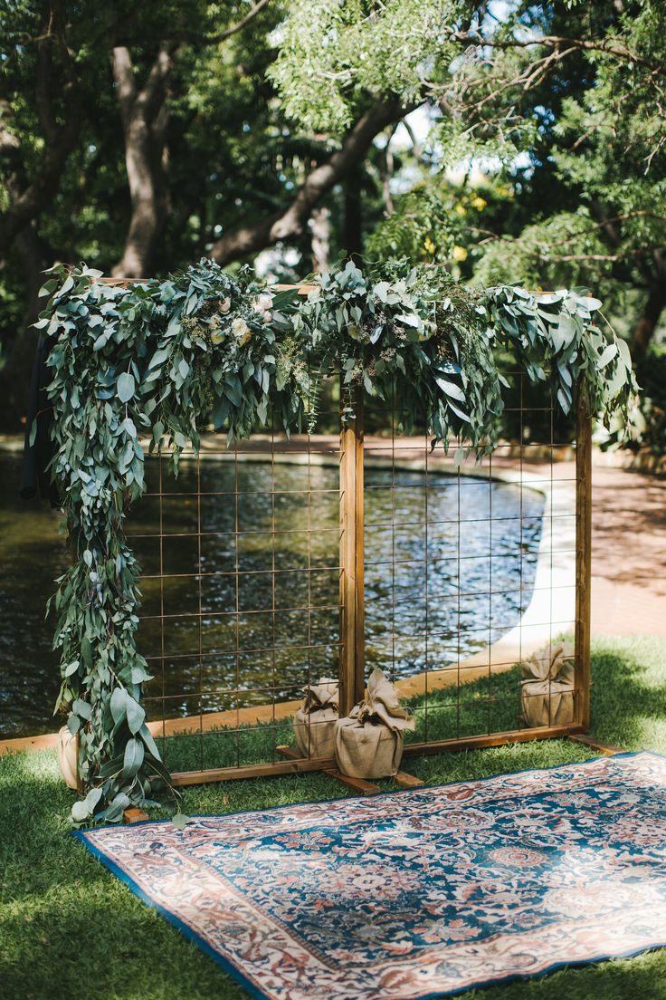 """DY.o events (aka Duo)  """"Arthur"""" Mesh Wedding Ceremony Backdrop by Owl and Bear. Persian Navy rug. Full greenery installation to ceremony arbour."""