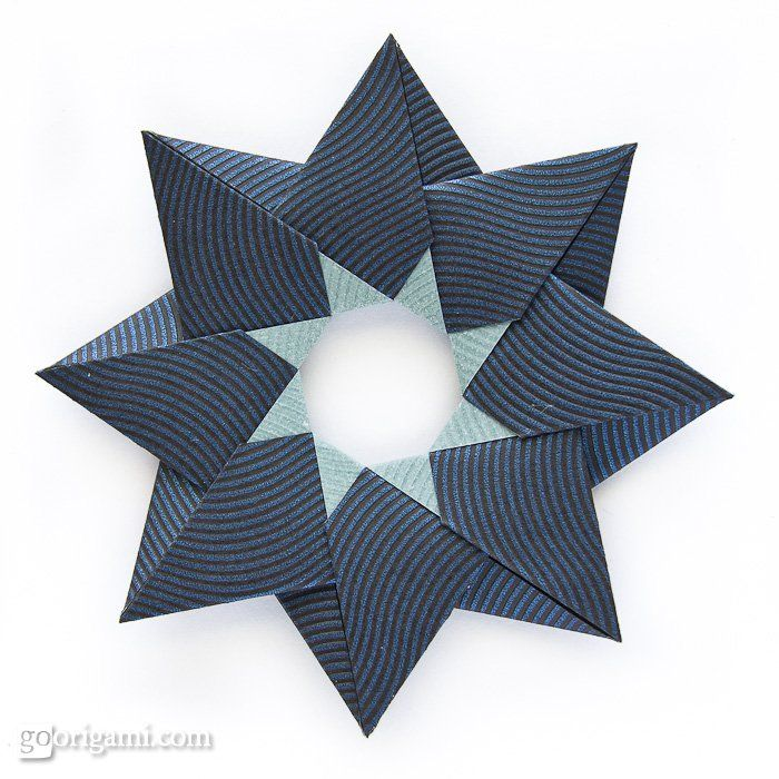 This is a modular origami star, Robin Star, made from 8 square sheets of paper, no glue needed. It's double-sided and I'm not even sure which side is the front and which is the back,
