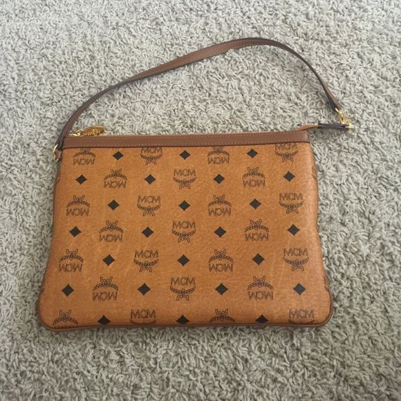 Mcm clutch Barely worn mcm clutch MCM Bags Clutches & Wristlets