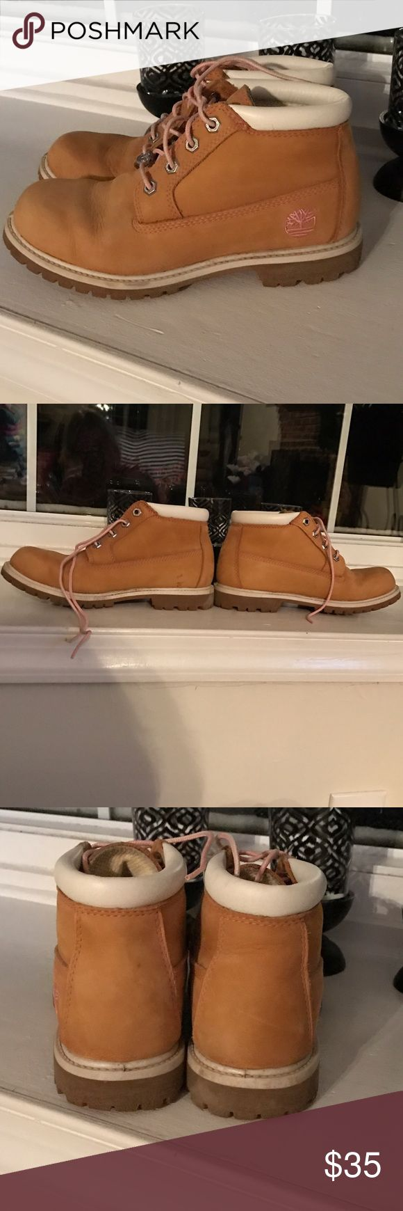 Pink and Tan Ladies Timberland Boots Pink and Tan Ladies Timberland Boots Size 7.5. Few small marks (shown in pictures, not very noticeable in person) Timberland Shoes Combat & Moto Boots