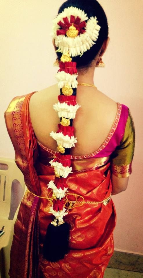 traditional south indian bride in bridal braid hairstyle ...