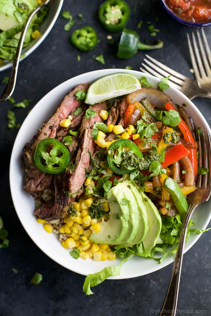 Homemade STEAK FAJITA BURRITO BOWLS filled with quinoa, fajita steak, avocado and a cilantro lime chimichurri sauce you'll adore. This quick Burrito Bowl is done in 30 minutes and is sure to be a favorite! | joyfulhealthyeats... | Gluten Free Recipes