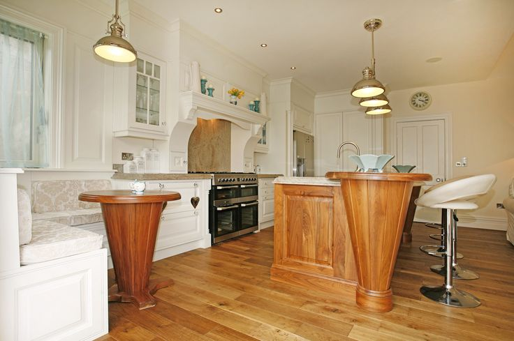 Classic kitchen in creams and walnut granite tops chrome light fittings with oak engineered floors