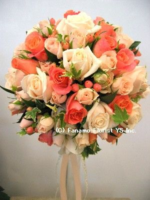 ASHLEY LOVES THIS BOUQUET IN A NOSEGAY STYLE WITH HER CORAL REEF DAVIDS BRIDAL WEDDING COLOR, IVORY & GREEN FLOWERS ARE ALSO APPROVED