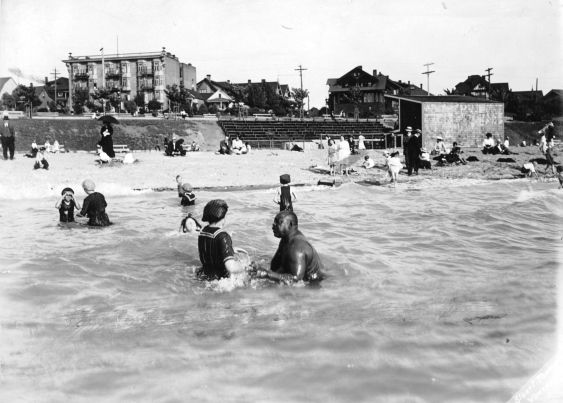 Joe Fortes teaching a young girl to swim at First Beach - City of Van archives photo