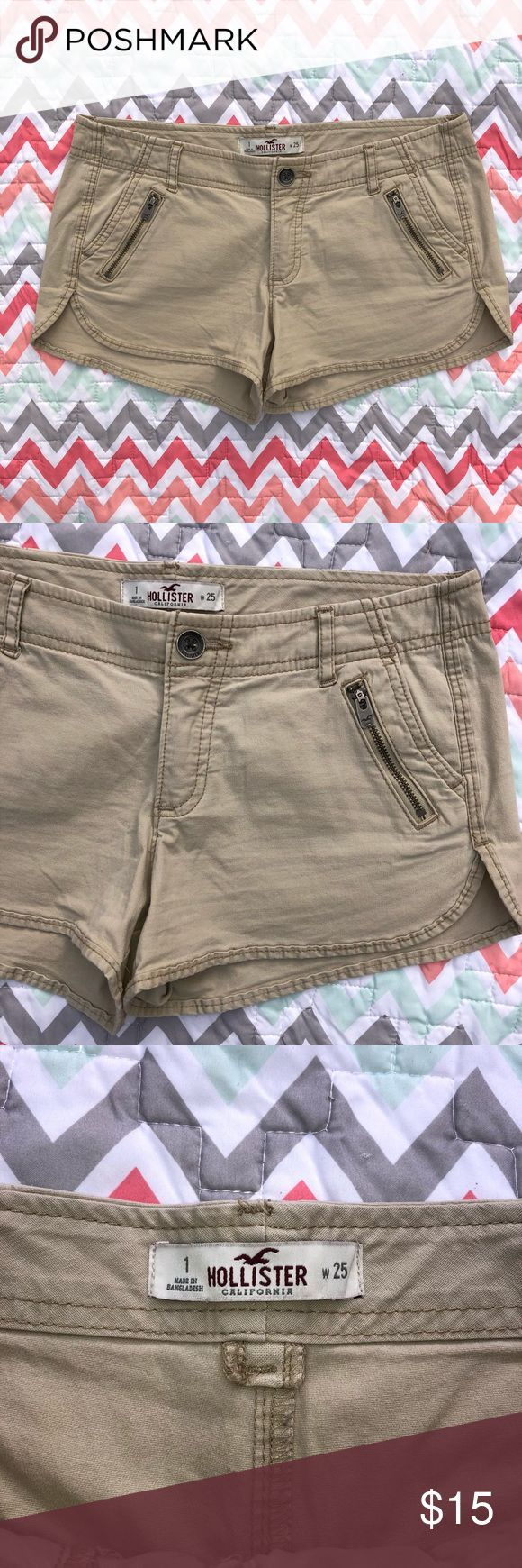 1/25 Hollister Zip Pocket Curved Hem Khaki Shorts Details: Tan almost brown khaki like cargo shorts. Very very light weight material. Front zipper pockets and button zip fly front. Curved Hem leg design.   Brand: Hollister  Size: 1 (25) (Juniors) -would also fit Women's just please know your size when converting.  Condition: NWOT new without tag   @CksOverload Hollister Shorts