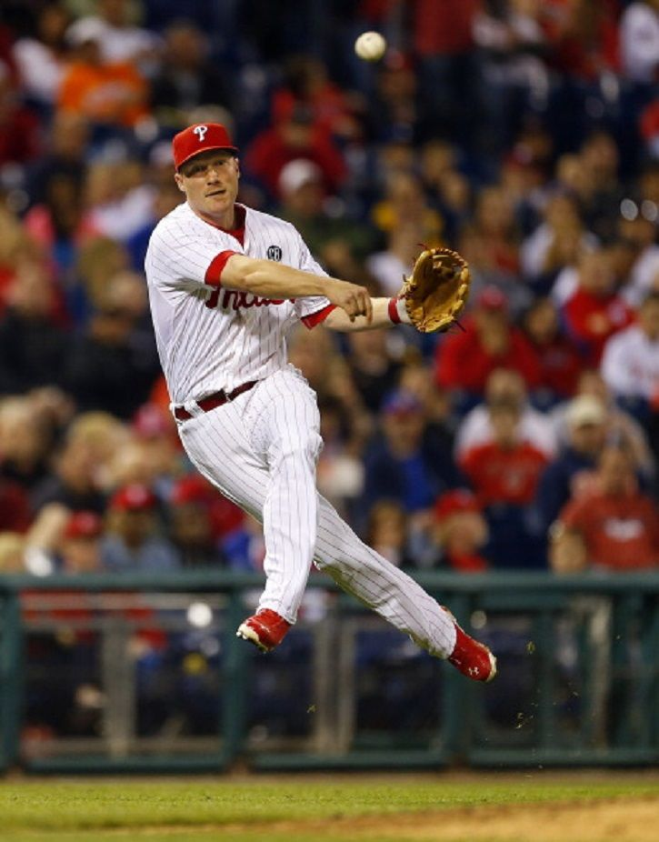 Third Baseman Cody Asche #25 of the Philadelphia Phillies makes a throw to first on a ball hit by Tucker Barnhart #16 of the Cincinnati Reds during a 2014 game at Citizens Bank Park in Philadelphia, Pennsylvania. The Phillies defeated the Reds 12-1.