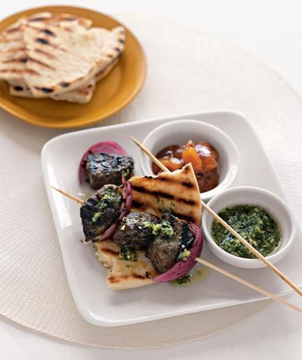 Indian-Style Beef Kebabs With Cilantro Sauce recipe: Marinate the steak in a mixture of cilantro, onion, garlic, chili, ginger, and curry for maximum flavor.