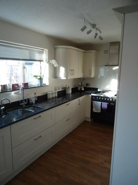 Shiny Black Granite worktop - Real Kitchens