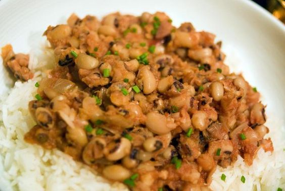 This is a hoppin' John recipe, made with black eyed peas and chopped vegetables, along with a ham bone or ham hocks and seasonings. This is an essential dish for New Year's Day (for good luck!).