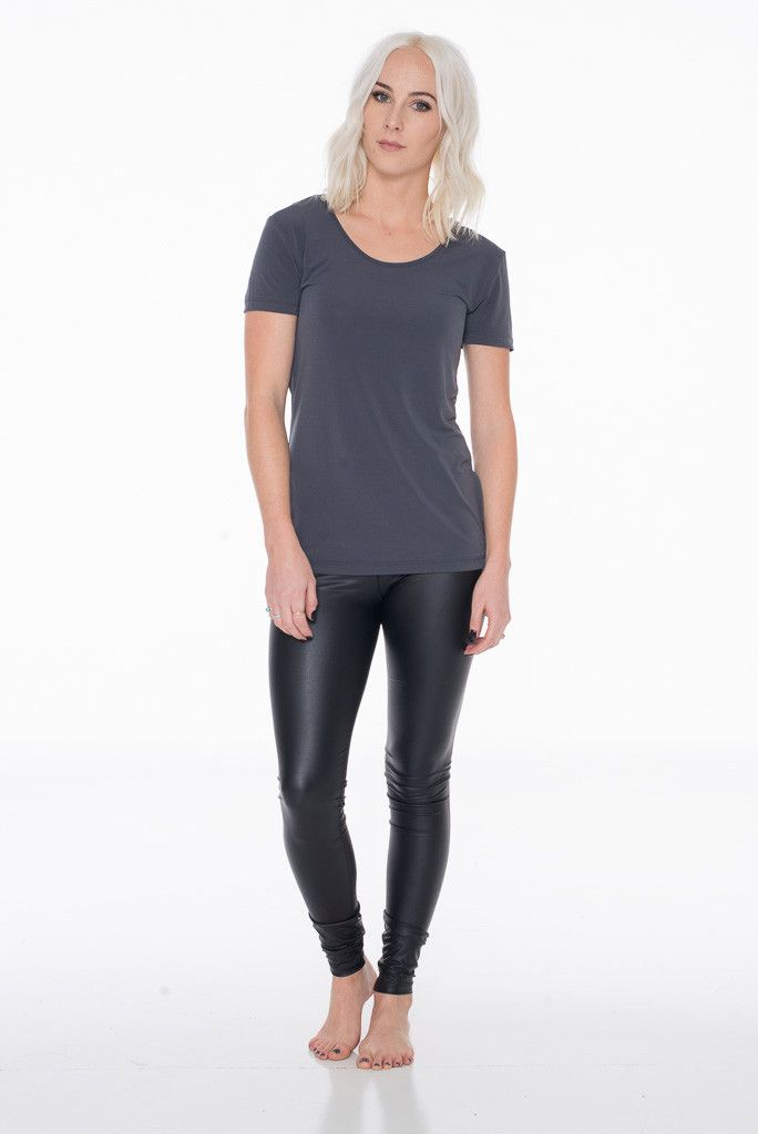 Fitted legging. Elastic at waist. This legging is made with medium weight pleather fabric that is soft and has great stretch. - Model is wearing size small - May want to size up - Polyester/Spandex -