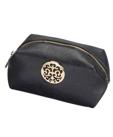 Ny sminkväska i mellanstorlek, gärna en som är lätt att torka av invändigt.