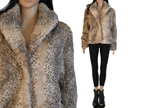 Super soft pale beige and brown spotted faux fur jacket with large collar.  One front flexi hook-loop closure.  Hidden side slit pockets. Fully lined