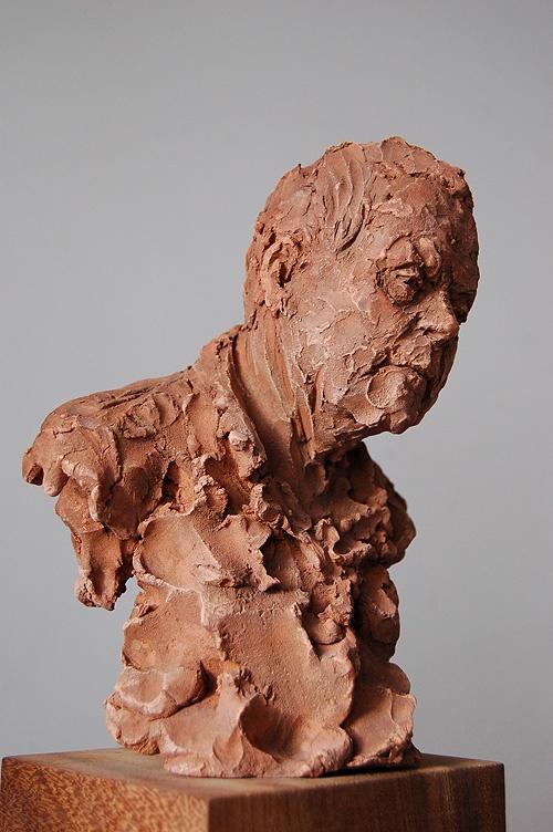 Richard by Suzie Zamit.   Portrait in terracotta