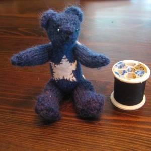 Harold is a star! A tiny, hand-made, knitted, fully jointed bear that's only twice as big as a cotton reel. Squee!