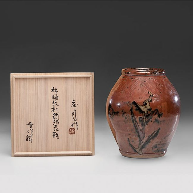 "Shoji Hamada (1894-1978; Japan), Tan on Persimmon Vase, ca. 1943, stoneware with wax resist, 11.75″ x 9.5,"" includes artist-signed box."