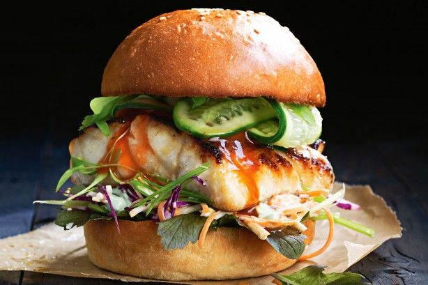 Miso fish burger with pickled cucumber and slaw