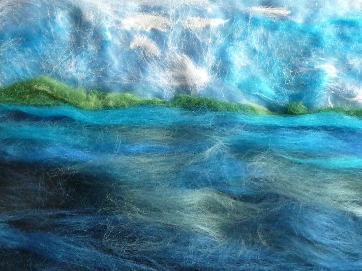 Fibres laid out and ready for the soap and water: this seascape will be wet-felted into a notebook cover.  You can see more by Littledeb at www.facebook.com/LittleDebFelts.