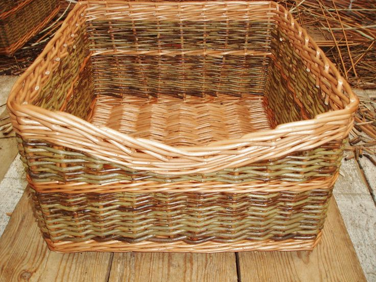 The finished basket in buff and green willow with dipped front and track border.