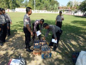 Jelang Puasa Ramadhan Polsek Dolopo Lakukan Pemusnahan Minuman Keras