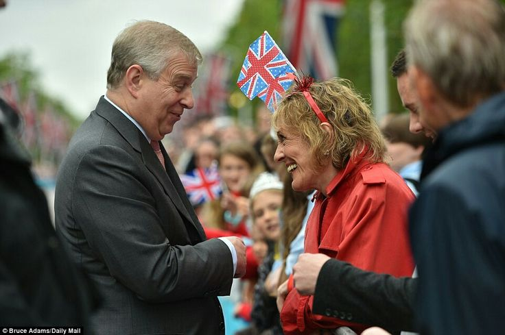 Pleased to meet you: One reveller dressed in a red trench coat and headband appeared extremely excited to speak to Prince Andrew   Pleased to meet you: One reveller dressed in a red trench coat and headband appeared extremely excited to speak to Prince Andrew