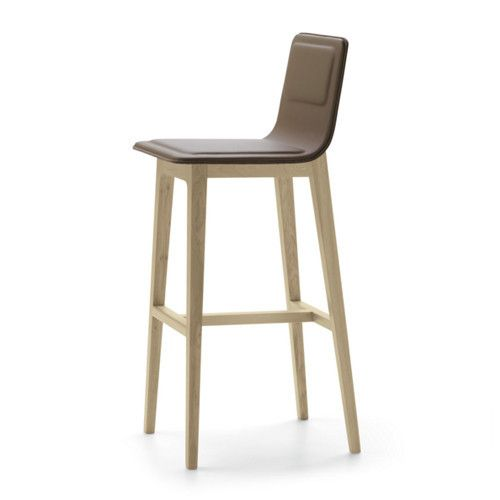 The Laia Stool is made using a solid oak structure. The rear covering is made from felt with 4 mm thickness. The front covering is vegetable based foam with a choice of leather or fabric to choose from. Designed by Jean Louis Iratzoki, the Laia collection is a reflection of Alki's commitment to sustainable development.  It features a simple oak frame topped with a plywood shell covered with foam, felt and wool.