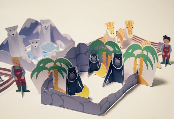 Family Zoo cut n´ glue paper toy.    Our friendly Zoo houses moms, dads and babies of 6 different animals: we have giraffes, polar bears, crocodiles,